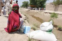 Photo of a woman in Pakistan who has been displaced by flooding. Credit:UN Photo/WFP/Amjad Jamal
