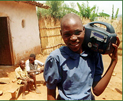 African boy holds a wind-up radio